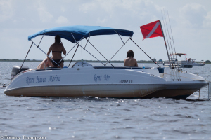 Rent a deck boat from River Haven Marina for $200 a day, plus gas and tax.