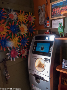 Satchel's doesn't take credit or debit cards, but there's an ATM.  And the ATM fees all go to charity!