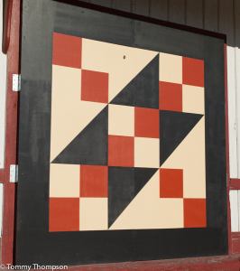 Simple quilt designs adorn the walls of downtown Trenton, FL