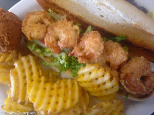 Fresh Gulf shrimp, fried in homemade buttermilk batter, is highly recommended, either as an entree or in a po-boy sandwich for lunch.