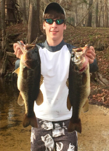 Jake Hartley with two nice Santa Fe River bass, caught on soft plastic baits.