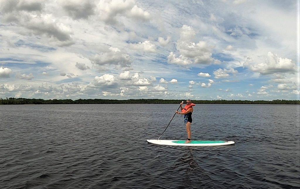 Woman paddleboarding on Lake Butler